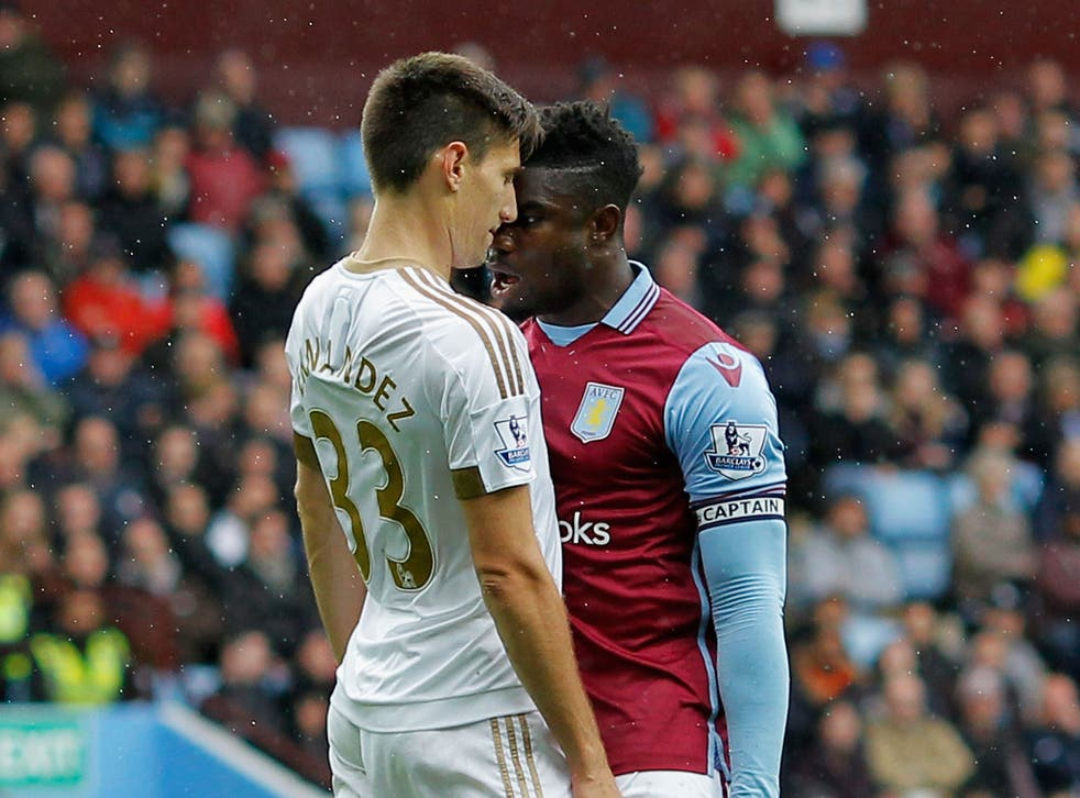 Aston Villa centre-back Micah Richards clashing with Swansea City's Federico Fernandez during the match on Saturday