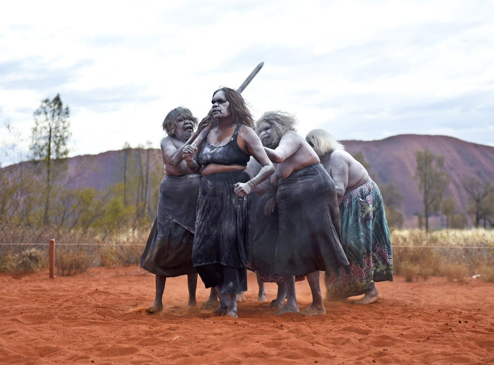 Aboriginal women perform traditional dances near Uluru to mark the 30th anniversary of the rock being handed back