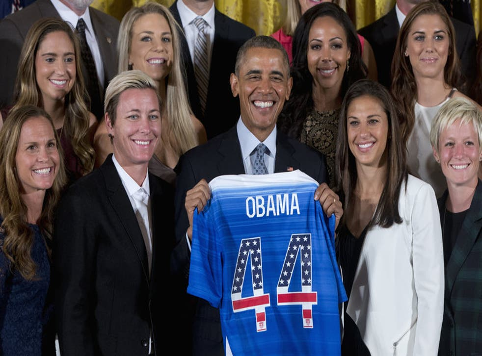 Obama kicks it (yup) with the US Women's National Soccer Team.
