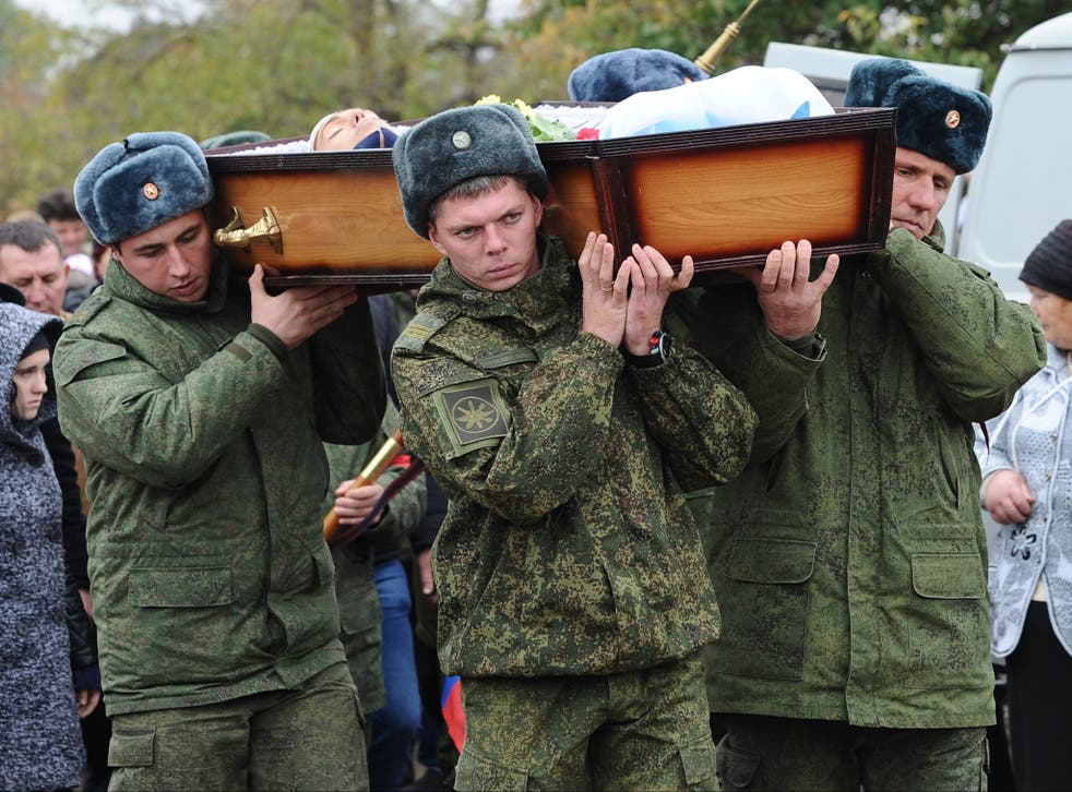 The body of 19-year-old serviceman was returned to his family in southern Russia on the day of his funeral