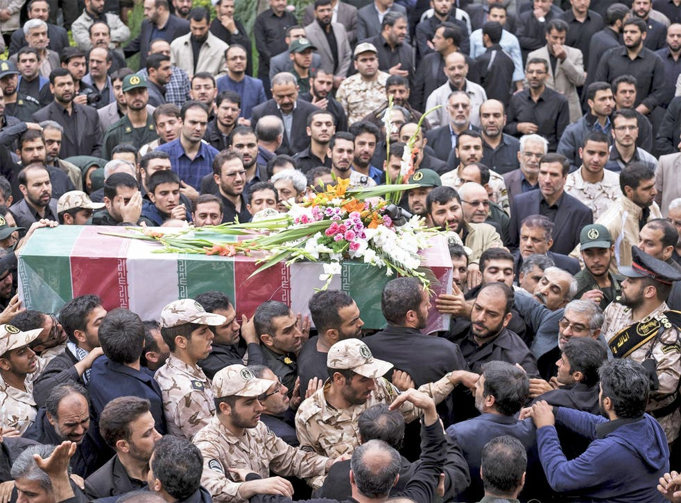 Mourners fill a Tehran street for the funeral of Abdollah Bagheri, a bodyguard of former Iranian President Mahmoud Ahmadinejad. Mr Bagheri was reportedly killed while guarding a shrine in Aleppo, Syria