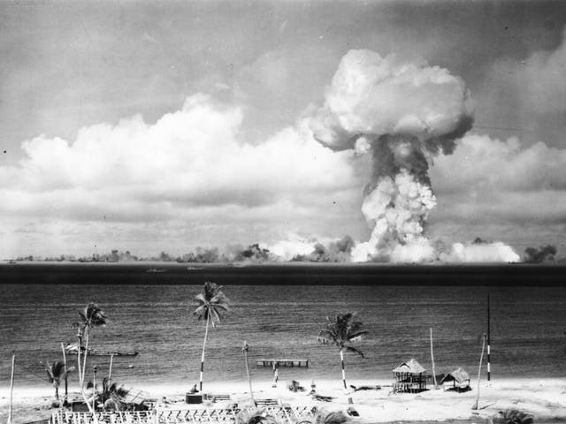 A mushroom cloud forms after the first nuclear test off Bikini Atoll in July 1946