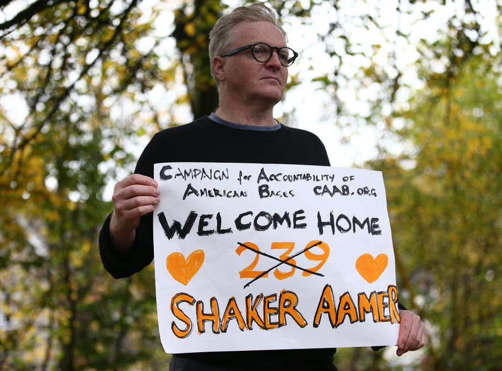 A campaigner at Biggin Hill Airport welcomes Shaker Aamer home