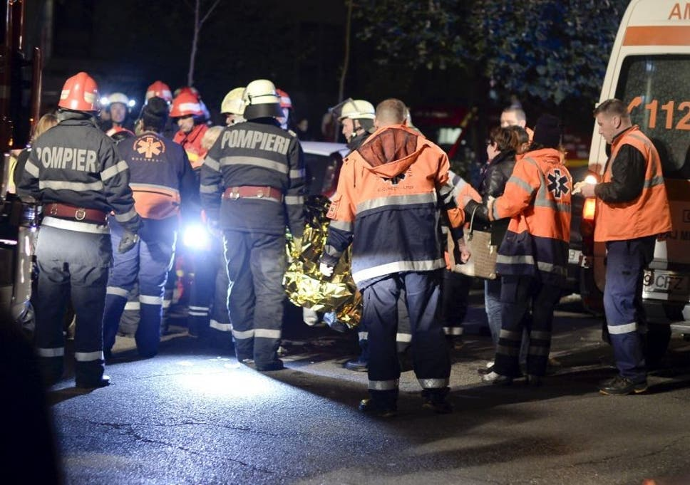 Emergency services respond to the disaster outside the Colectiv nightclub in Bucharest