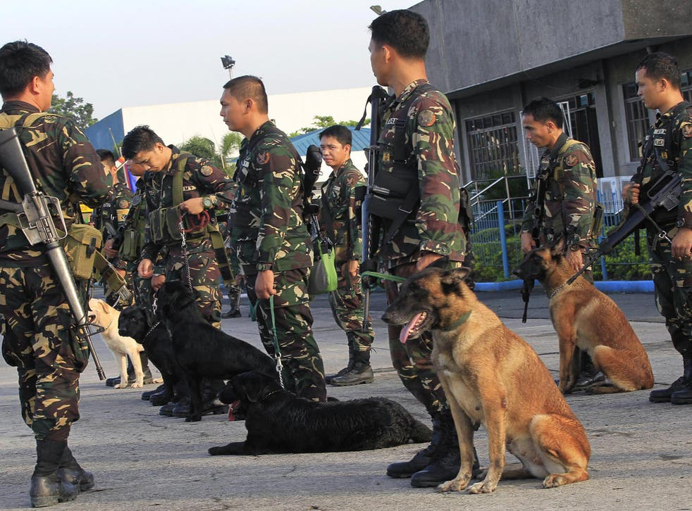 Filippino soldiers preparing to rescue hostages (file photo). Abu Sayyaf have turned to kidnappings in recent years as they receive little outside funding
