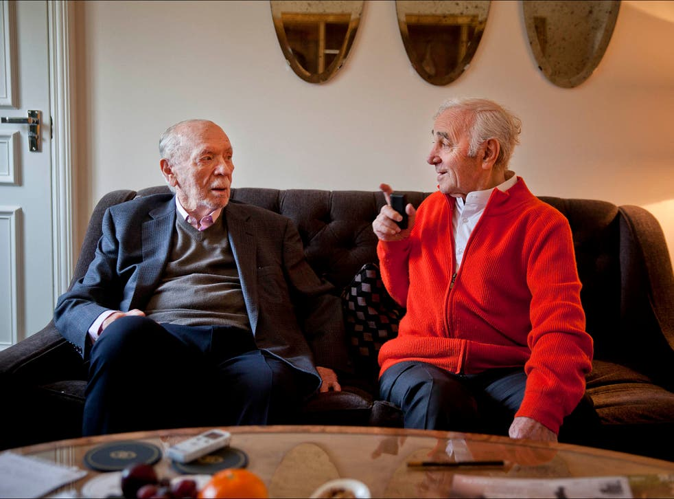 Charles Aznavour (red top) and Herbert Kretzmer, both in their 90s, meet at a London hotel.