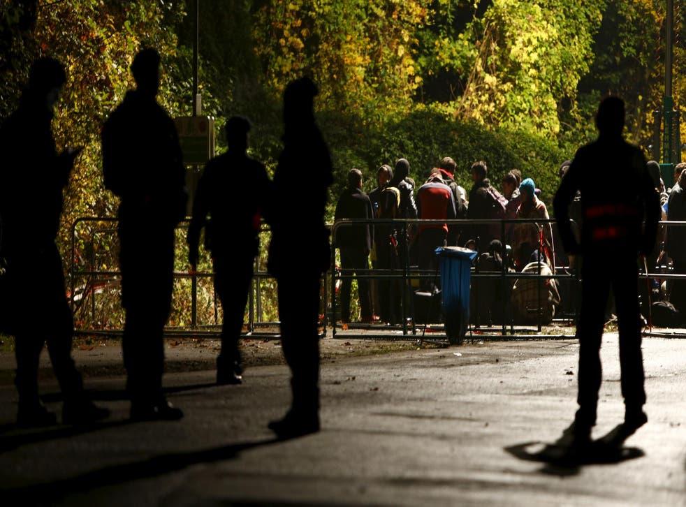 Refugees wait at the Austrian-German border in Achleiten
