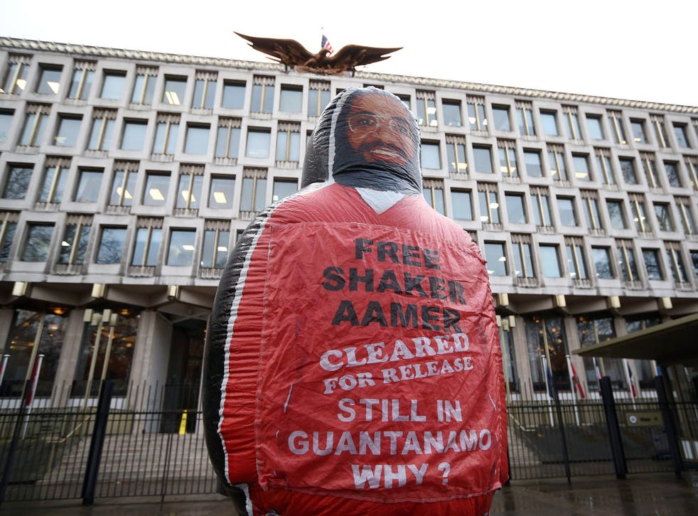 A giant inflatable figure of Shaker Aamer, the last Briton to be detained in Guantanamo Bay, is pictured during a protest by the We Stand With Shaker campaign group outside the U.S embassy in London, England.