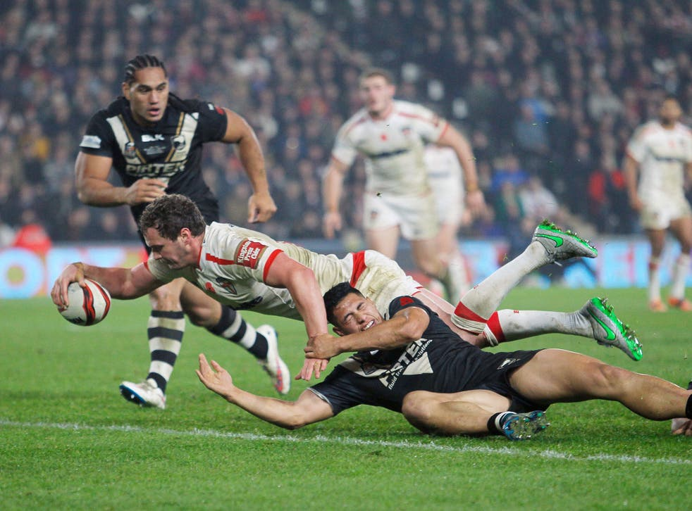 Sean O'Loughlin scores England's fourth try to make the game safe against New Zealand at the KC Stadium