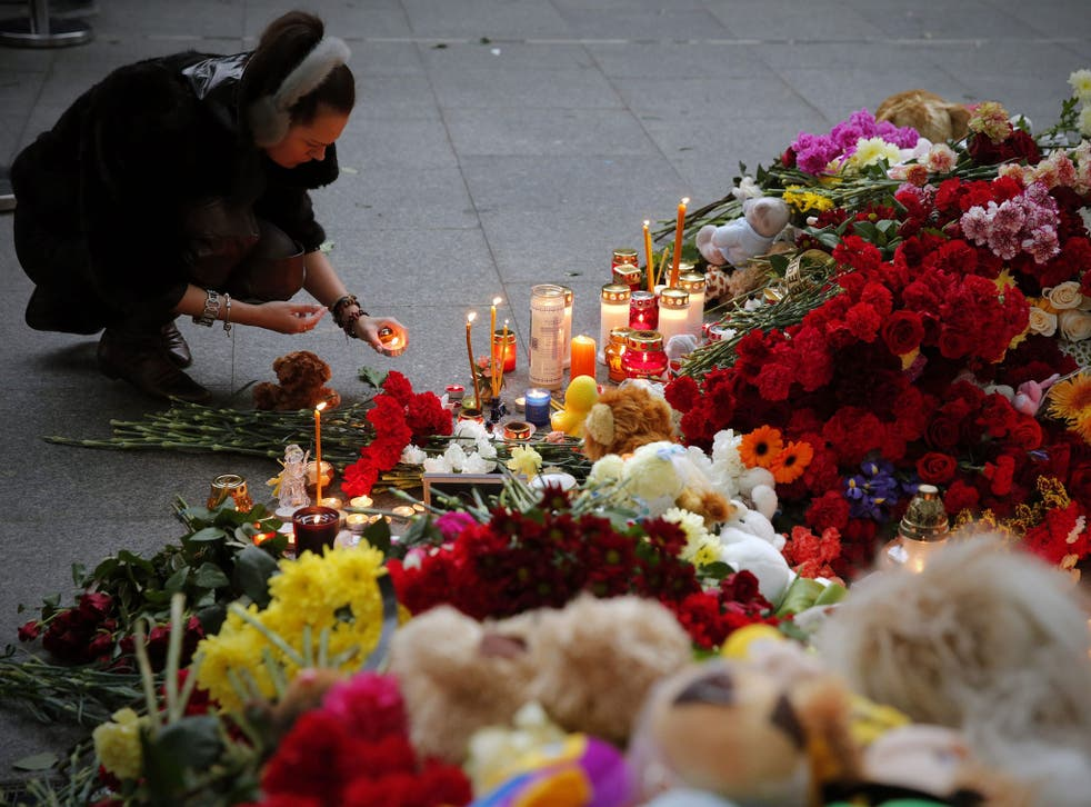 Russian people lay flowers and light candles to memory of victims at Pulkovo airport in St Petersburg