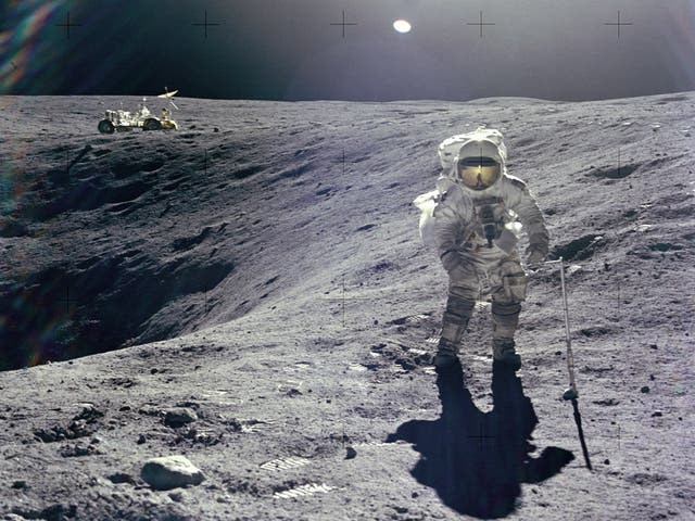 Astronaut Charles M. Duke Jr., Lunar Module pilot of the Apollo 16 mission, is photographed collecting lunar samples