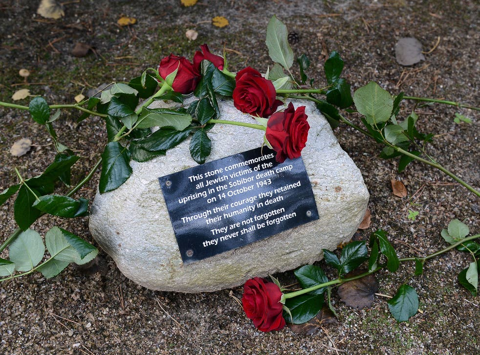 Flowers were laid in the woods next to the Sobibór World War II Nazi extermination camp on 14 October, 2013 to commemorate the 70th anniversary of an uprising in the camp