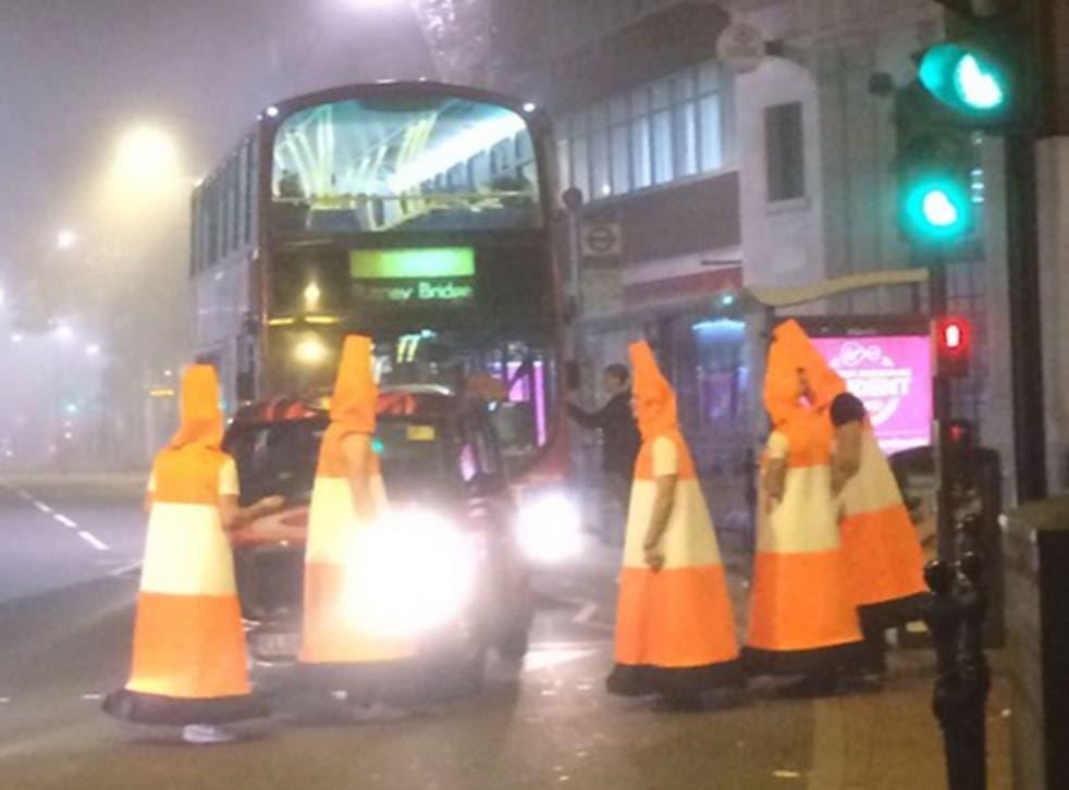Men dressed as traffic cones block traffic in Clarence Street