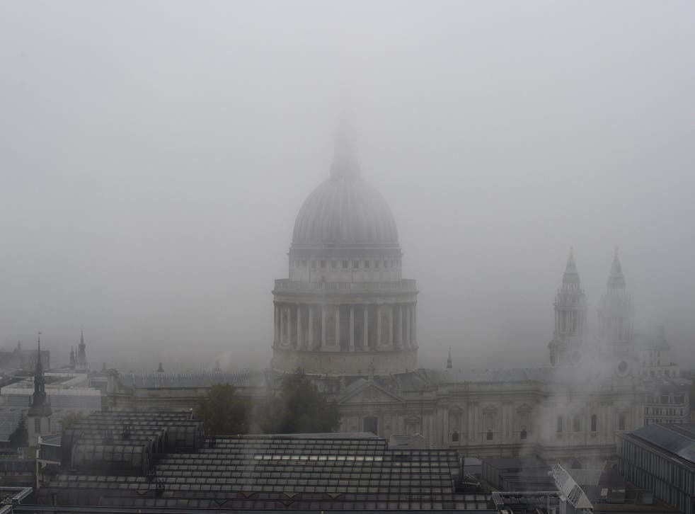 Fog shrouds St Paul's Cathedral in central London