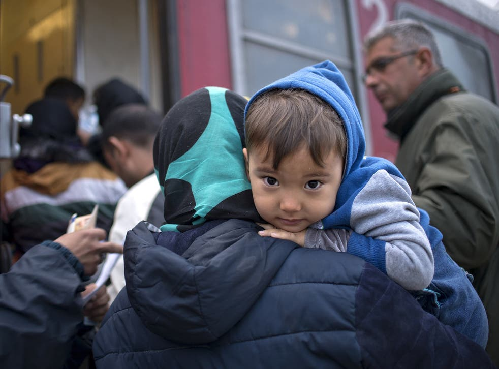 A young asylum seeker prepares to board a train heading to Serbia after crossing the Greek-Macedonian border. One in 10 of the world's children are now growing up in a conflict zone – some 230 million children