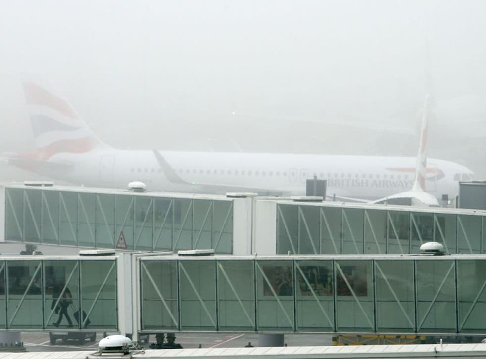 A British Airways plane at Terminal 5 Heathrow, as thick fog disrupted flights at UK airports for a second day