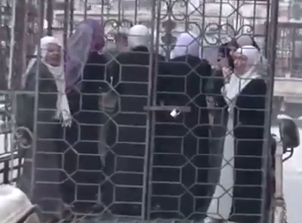 Footage of Alawite men and women being paraded through the streets of Damascus has emerged
