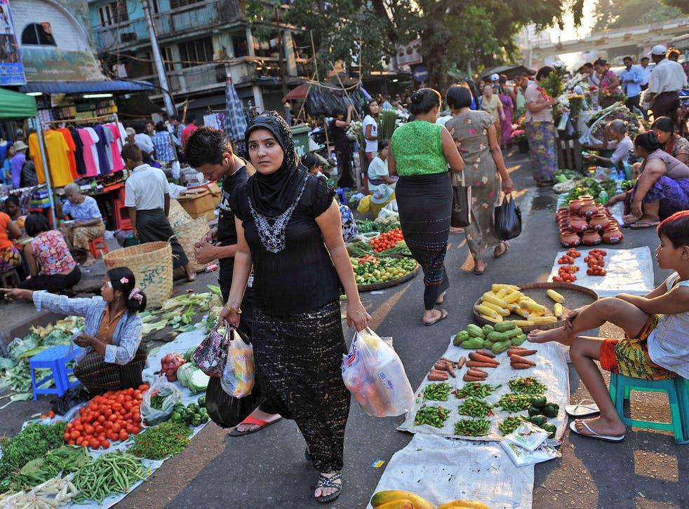 A Muslim woman shopping at a street market in Rangoon
