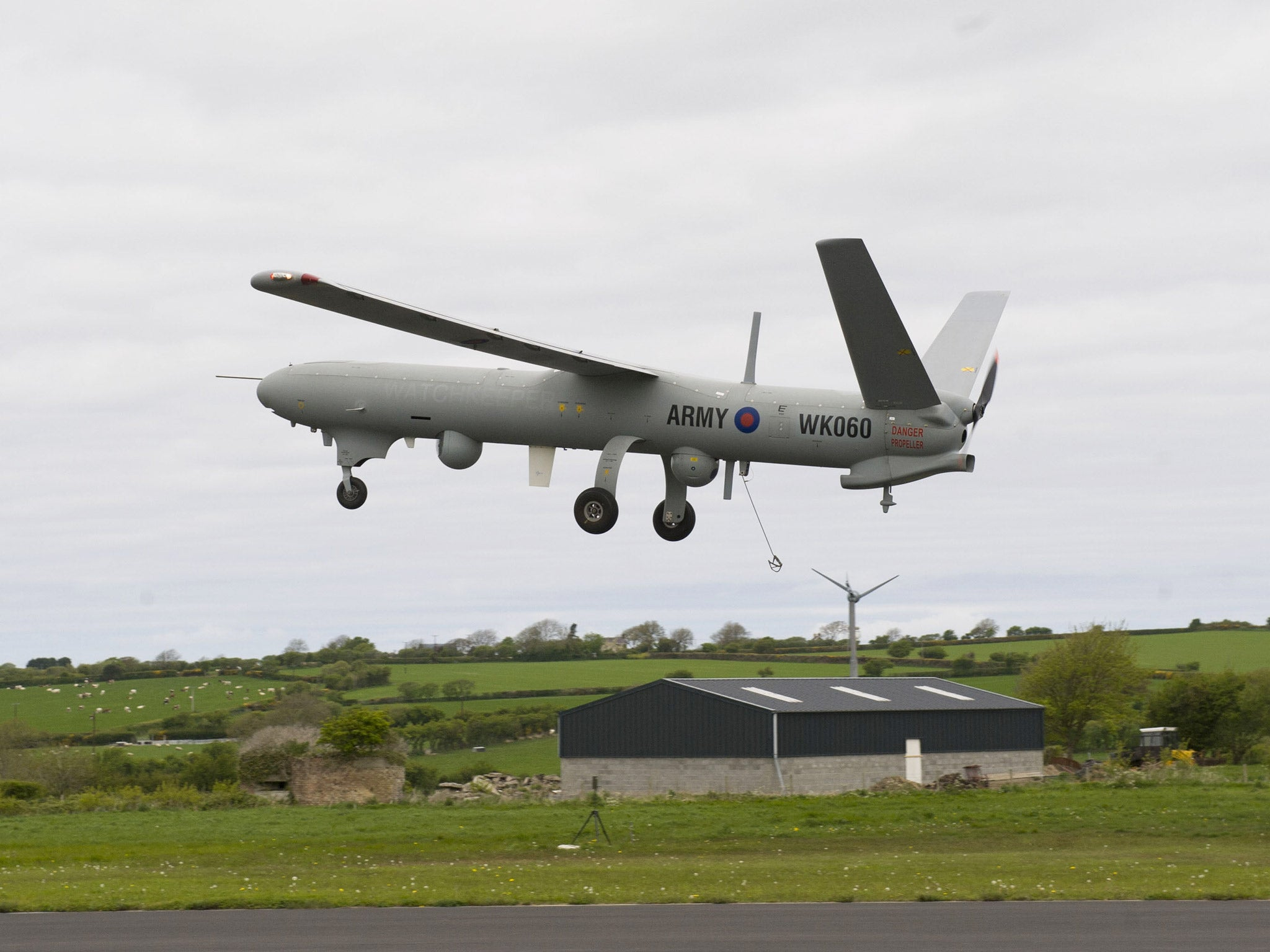 A £1m military drone flew over a packed primary school
