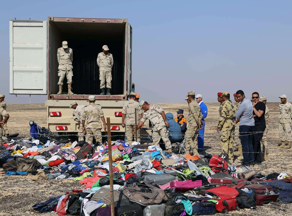 Russian emergency services personnel and Egyptian servicemen working at the crash site of a A321 Russian airliner in Wadi al-Zolomat, a mountainous area of Egypt's Sinai Peninsula