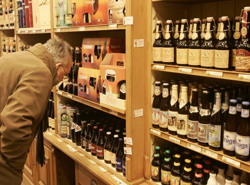 A man surveys the offering at a Brussels beer shop