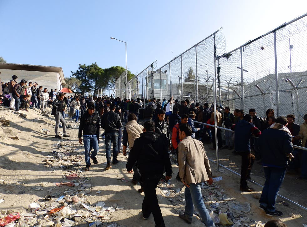 Asylum seekers queue to register at the Moria refugee camp in Lesbos, as numbers rose rapidly because of a backlog caused by a ferry strike trapping migrants on the island