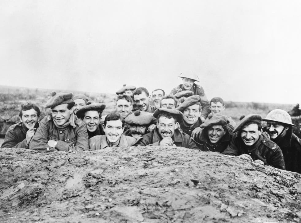 Gordon Highlanders smile for the camera from a reserve trench, 1916