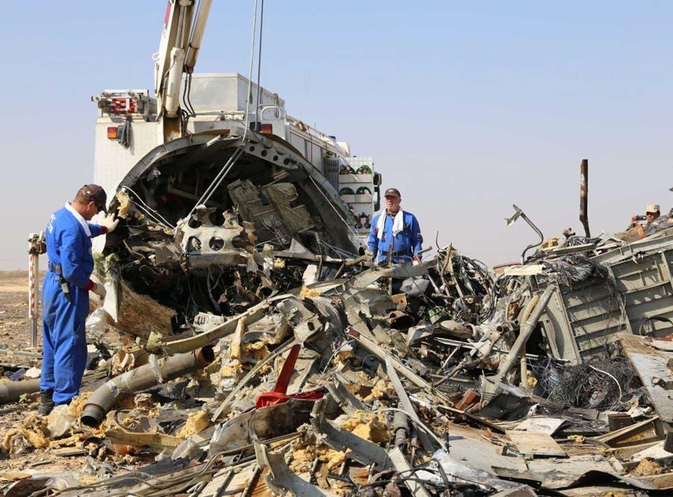 Russian investigators comb through the wreckage in the Sinai Peninsula