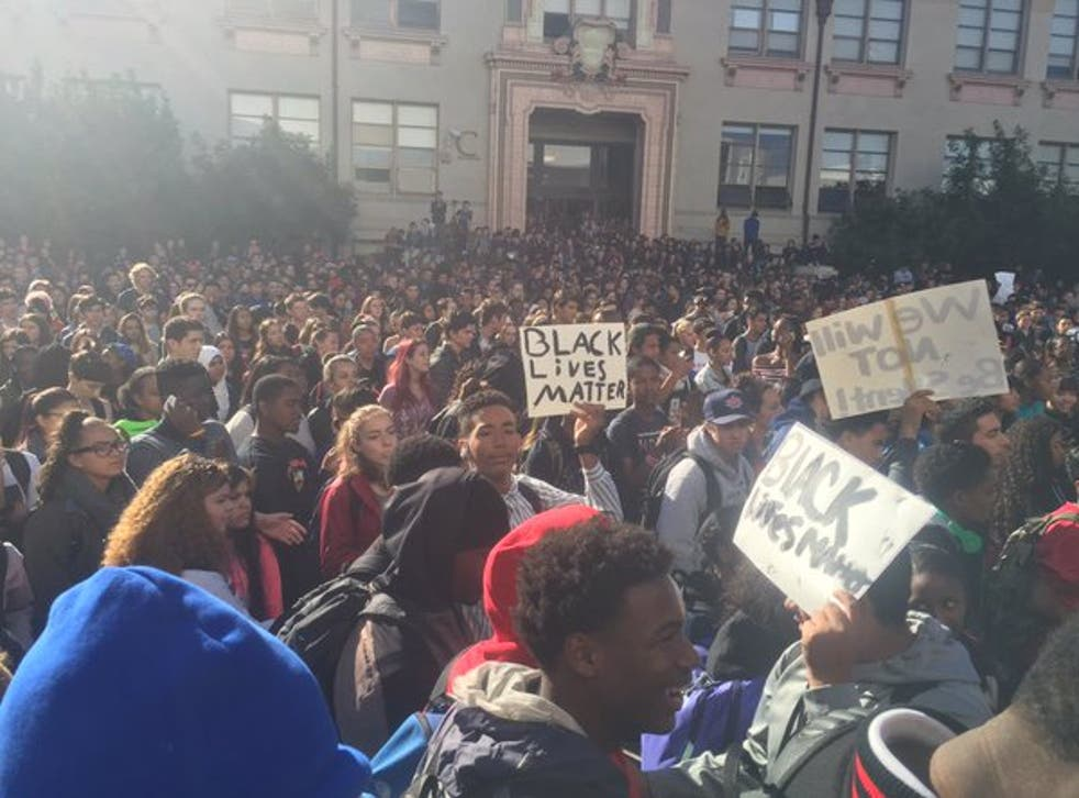 Students chant 'We got that unity!' and 'Say it loud, I'm black and I'm proud!' as they march through downtown to University of California, Berkeley