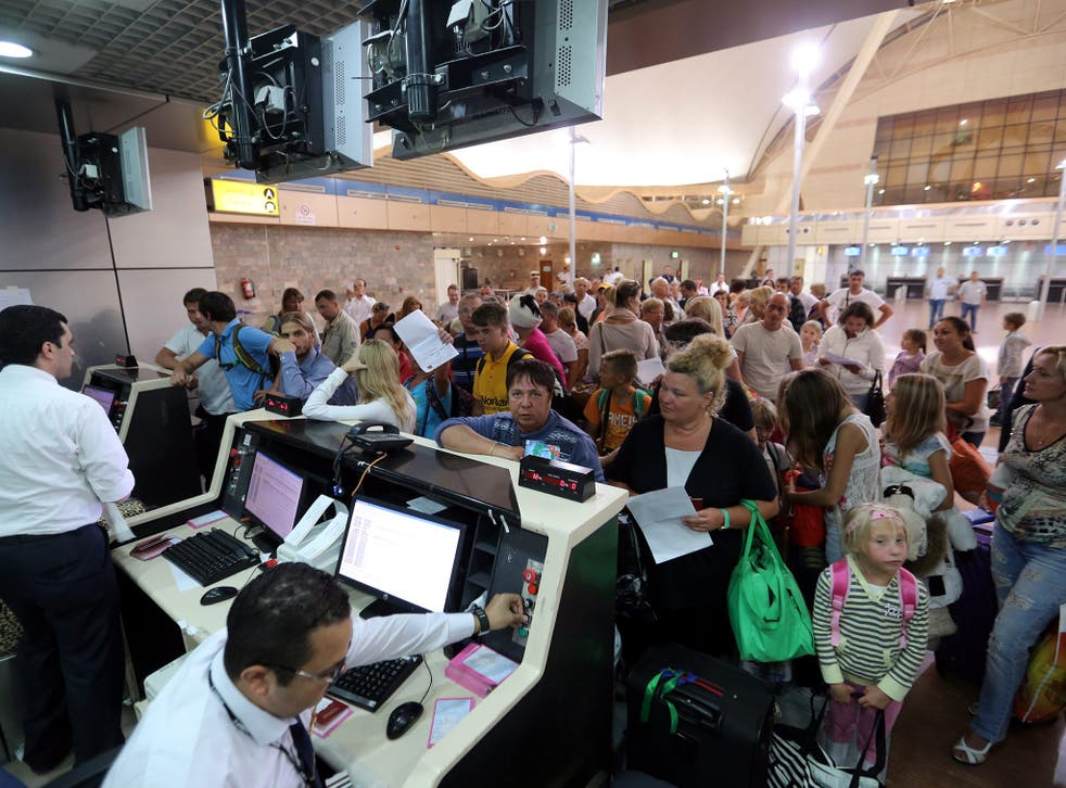 Russian tourists, leave at the Sham el-Sheikh airport in Sharm el- Sheikh, Egypt