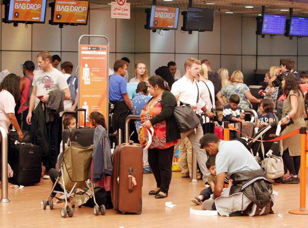 Passengers at Sharm el-Sheikh airport await information on their flights
