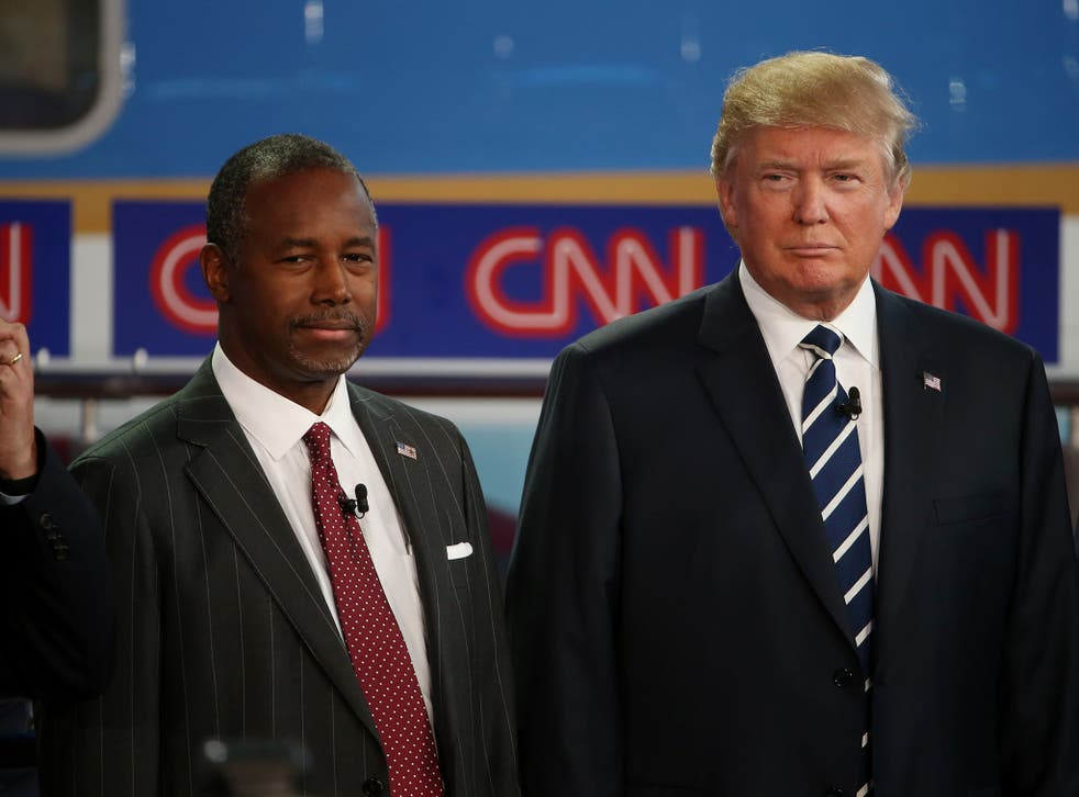 Ben Carson, left, and Donald Trump, lead the Republican race at 26 and 23 per cent respectively