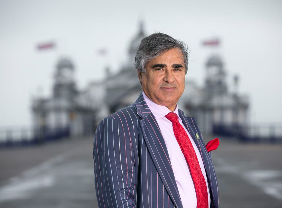 Sheikh Abid Gulzar in front of Eastbourne Pier