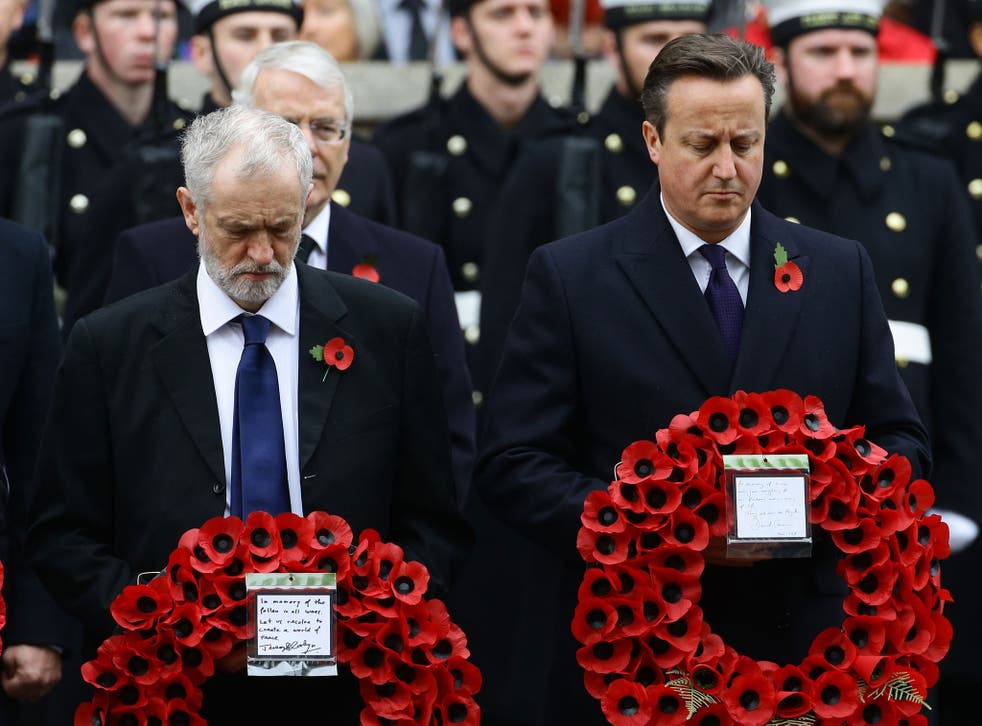 Labour party leader Jeremy Corbyn (left) and Prime Minister David Cameron wait to lay wreaths during the annual Remembrance Sunday service at the Cenotaph memorial in Whitehall, central London