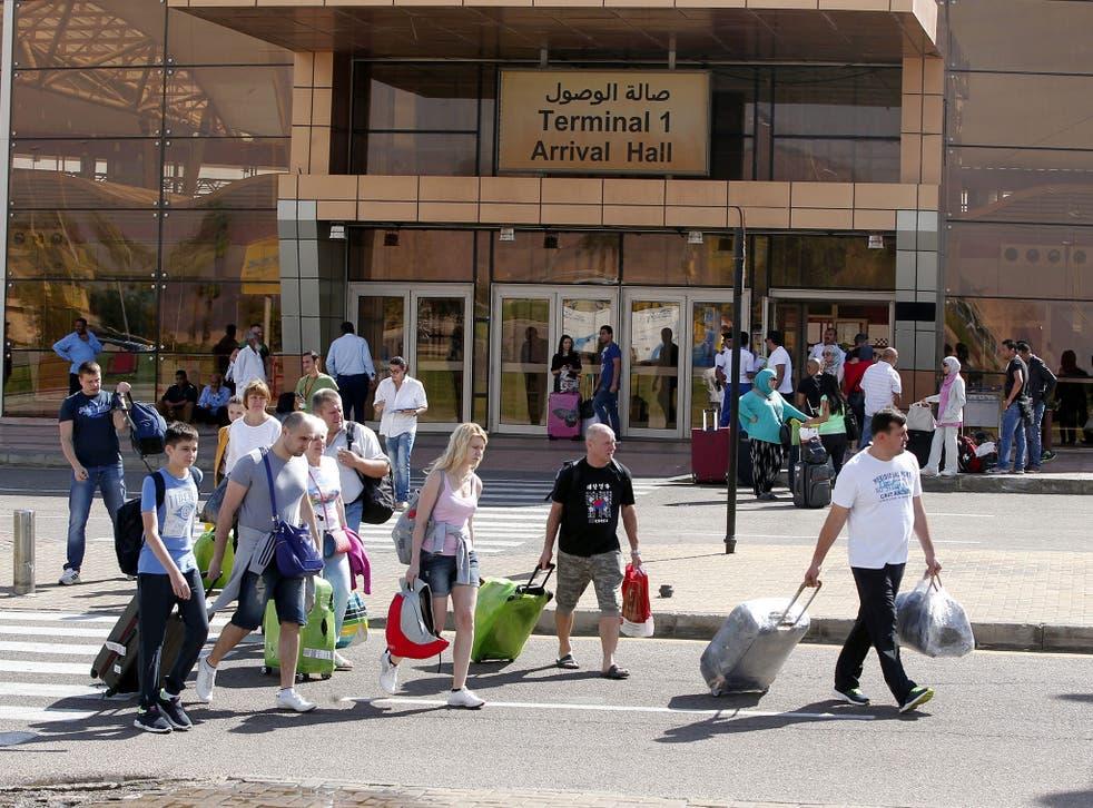Tourists walk outside Sharm el-Sheikh airport