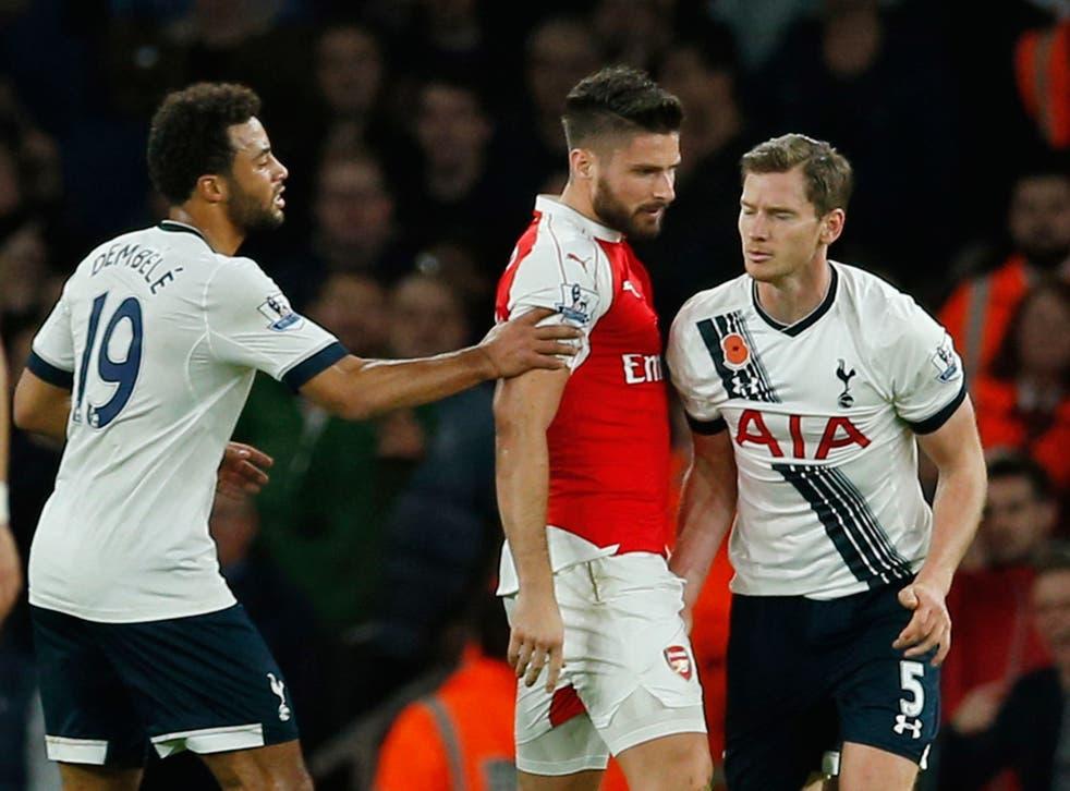 Jan Vertonghen appears to grab Arsenal striker Olivier Giroud