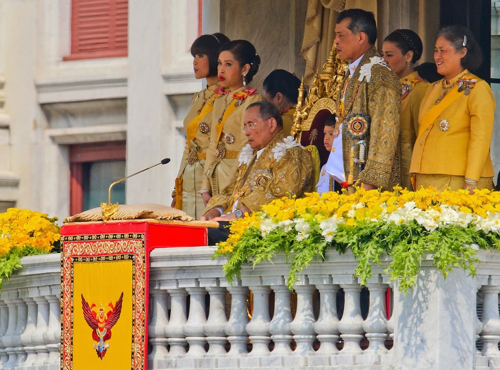 Thailand's King Bhumibol Adulyadej, surrounded by his daughters and his son, Crown Prince Vajiralongkorn,