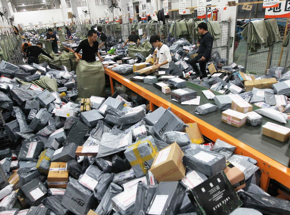 Express crew deal with express packages at assembly line on November 12, 2014 in Wenzhou, Zhejiang province of China. Online shopping websites offered massive discounts on Singles' Day (November 11) every year, which brings huge pressure to China's express delivery business during that day.
