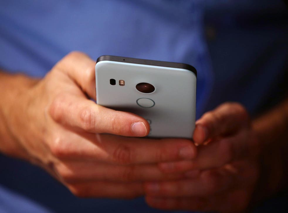 A man inspects the Nexus 5X at an unveiling event in September 2015