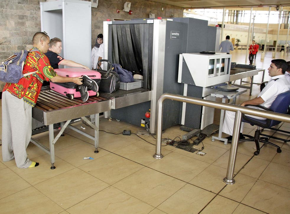 Security officials screen luggage at Sharm el-Sheikh Airport