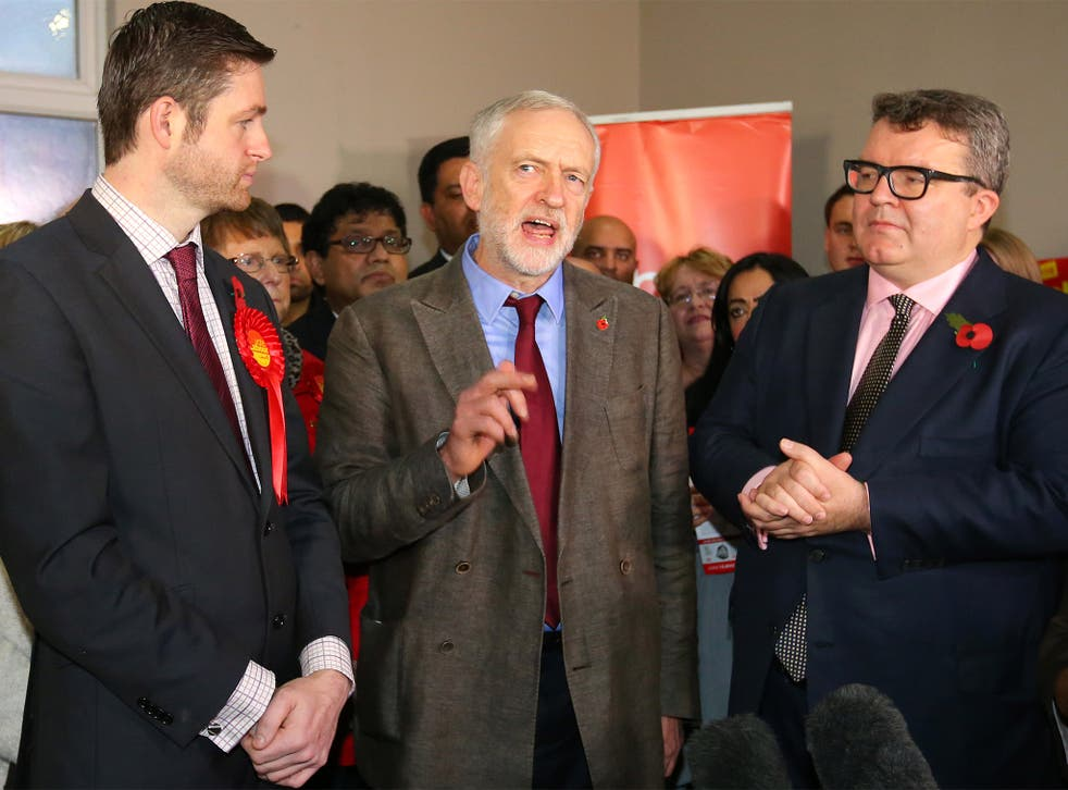 Labour leader Jeremy Corbyn with Deputy Leader Tom Watson, right, and candidate Jim McMahon, in Oldham, last week