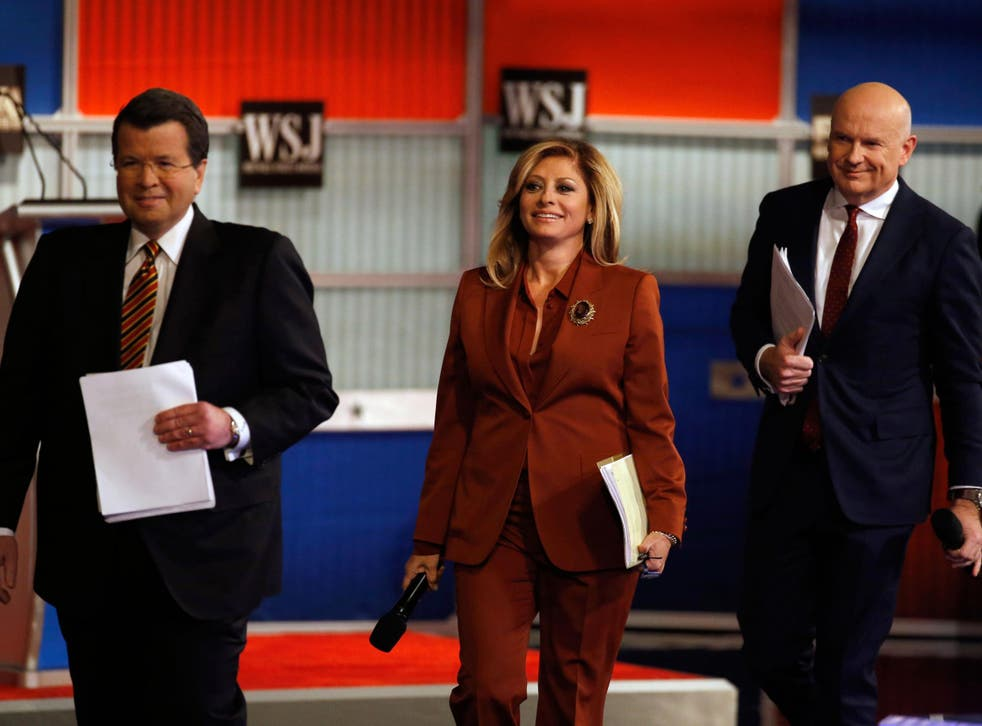 Moderators Neil Cavuto, left, Maria Bartiromo and Gerard Baker arrive on stage before the Republican presidential debate