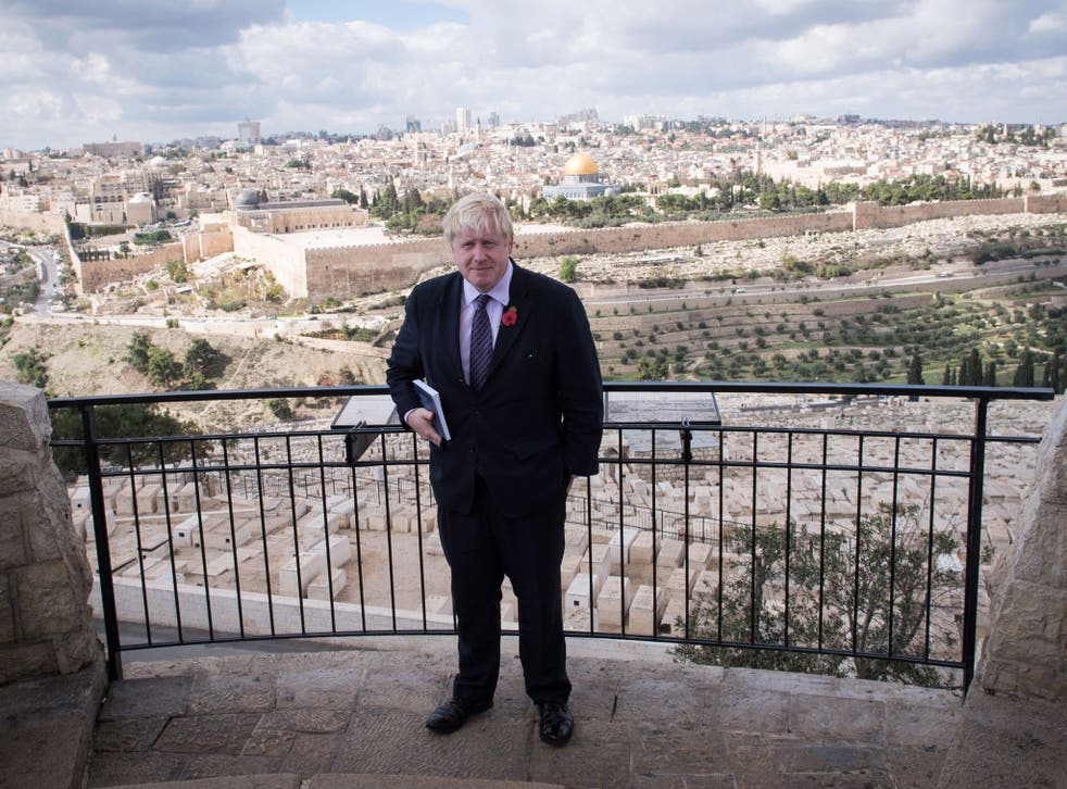 Mayor of London Boris Johnson looks out over the Old City of Jerusalem during his the last day of his visit on 11 November