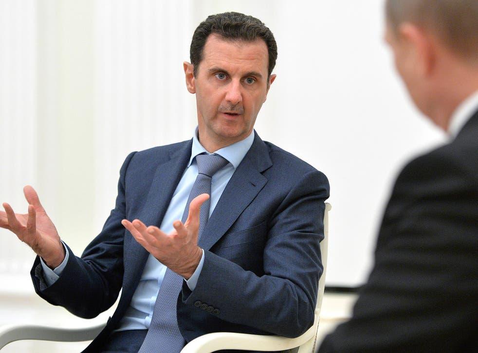 President Bashar al-Assad speaks with Vladimir Putin last month