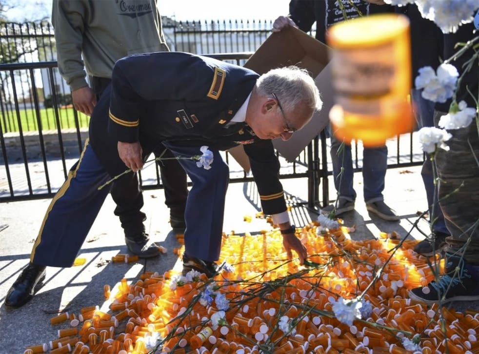 Veteran places symbolic empty pill bottle to highlight how veterans are over-medicated