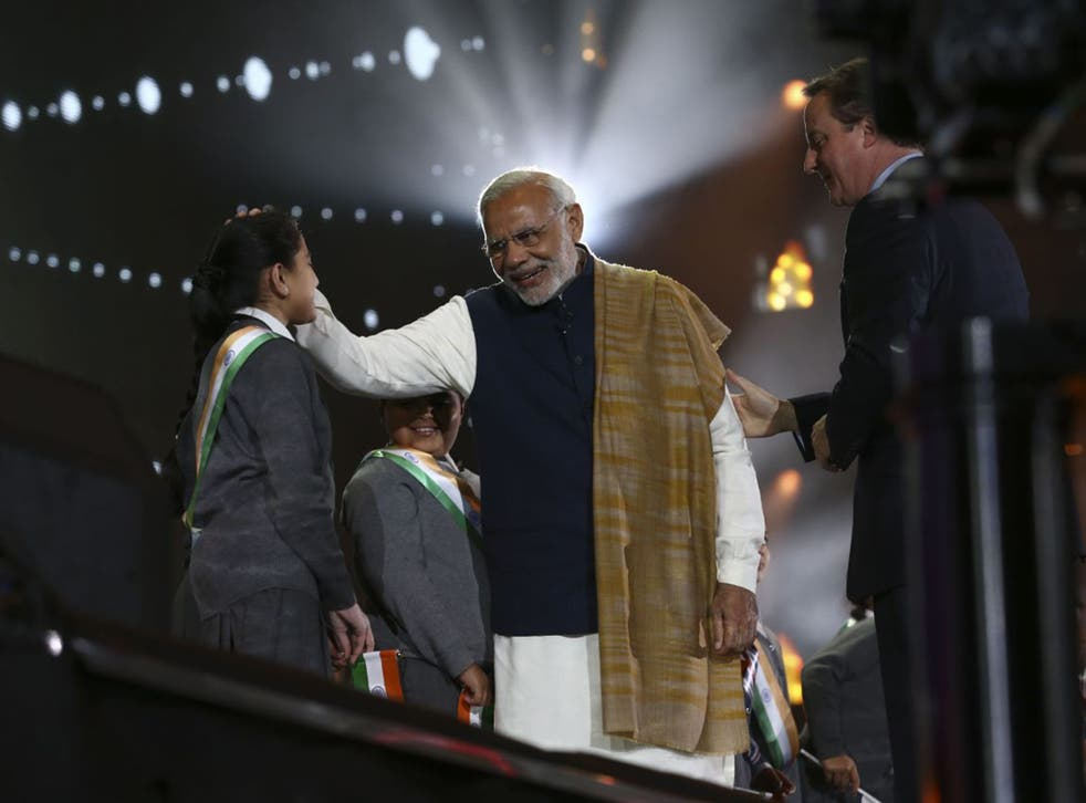 Narendra Modi and David Cameron greet schoolchildren who sang the national anthems of Great Britain and India at Wembley last night