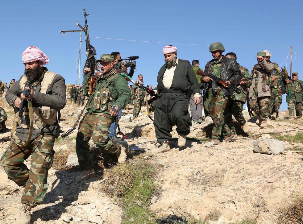 Kurdish peshmerga forces secured several strategic facilities in the northern Iraqi town of Sinjar on Friday