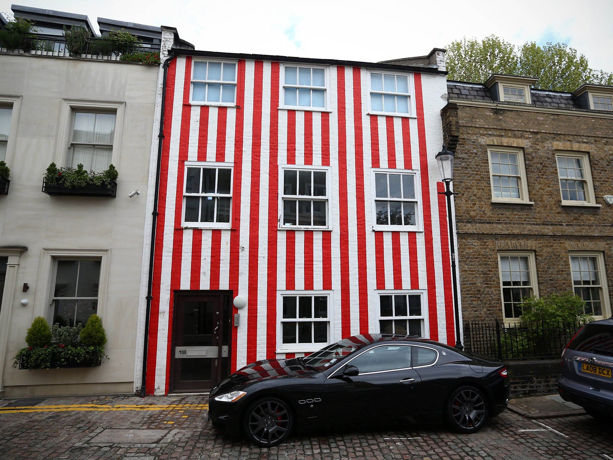 Red and white striped house owner is ordered to repaint Kensington ...