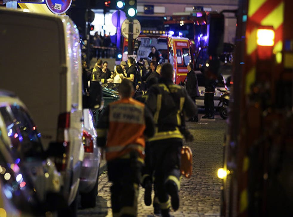 Police and rescuers work at the scene of an attack in Paris.
