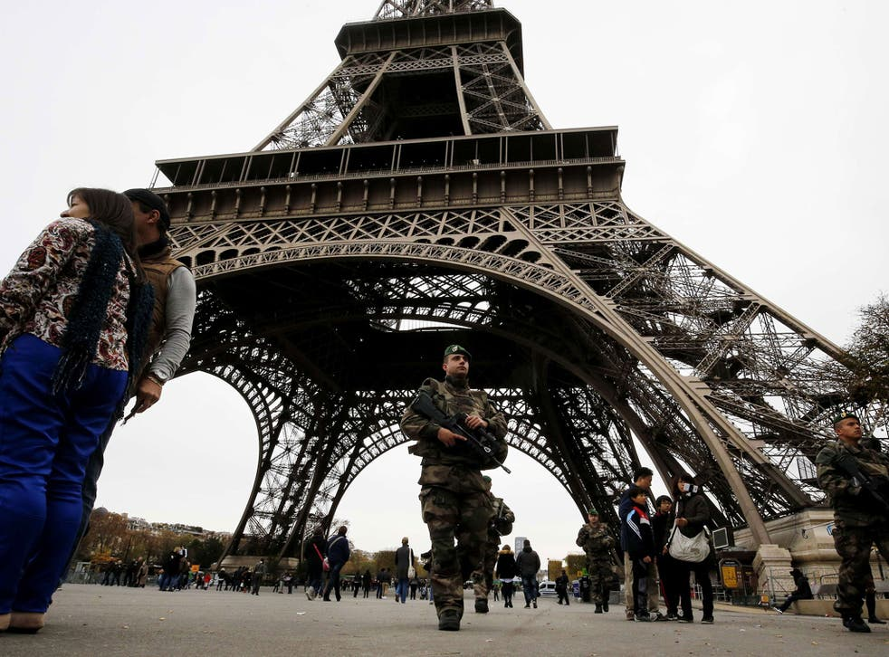 French soldiers patrol the area at the foot of the Eiffel Tower in Paris on November 14, 2015